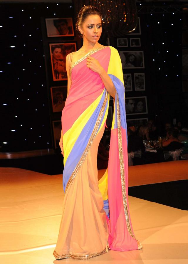 Models showcasing Manish Malhotra festive collection celebrating 100 years of indian cinema in London 08