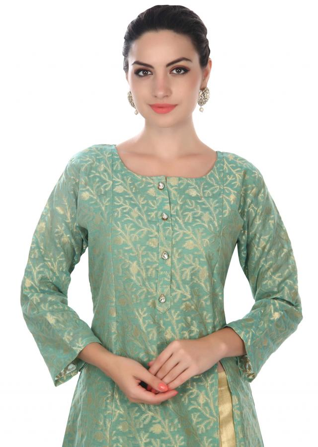 Mud green A line suit adorn in fancy button only on Kalki