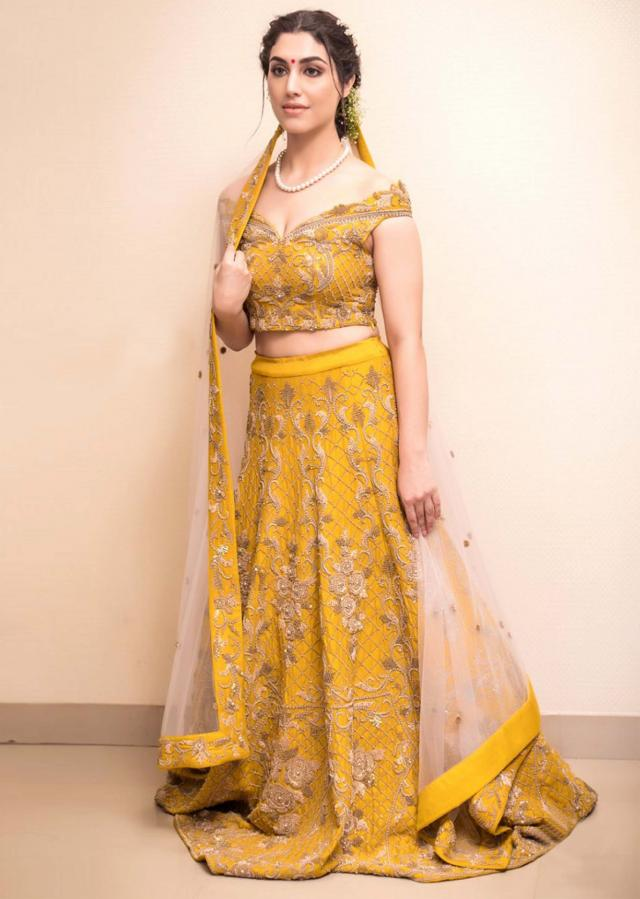 Niti Mohan in Mustard raw silk lehenga set with  heavy embroidery