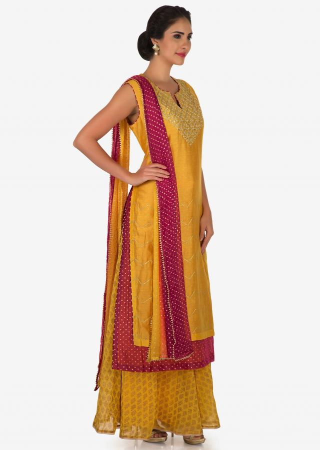 Mustard and pink palazzo suit in silk beautified with gota patti embroidery work only on Kalki