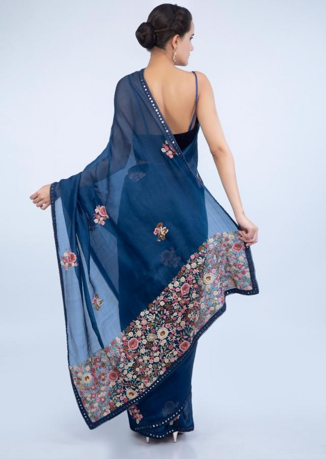 Navy blue organza saree with multi color floral embroidered butti and pallo only on Kalki