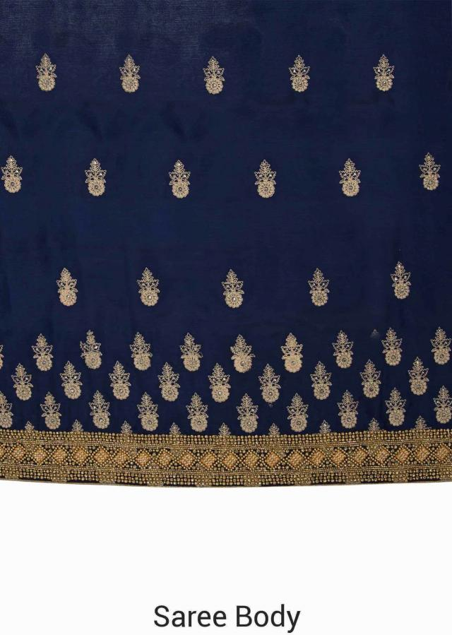 Navy blue satin chiffon saree embellished with thread butti and moti border only on Kalki