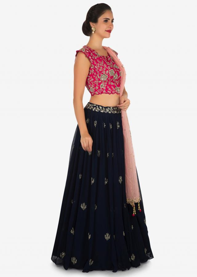 Navy blue and rani pink lehenga encrusted in zari and sequin embroidery work only on Kalki