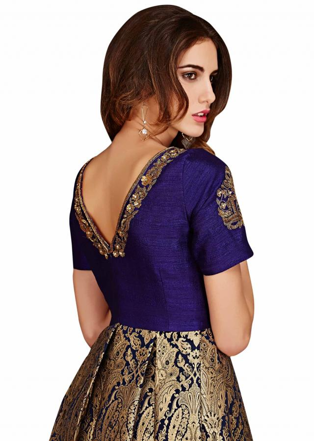 Navy blue brocade dress enhanced in box pleats only on Kalki