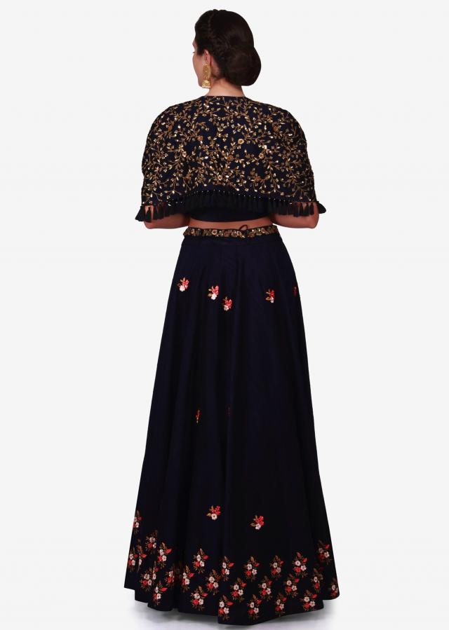 Navy blue lehenga in raw silk with a cape jacket embellished in heavy resham and zardosi work only on Kalki