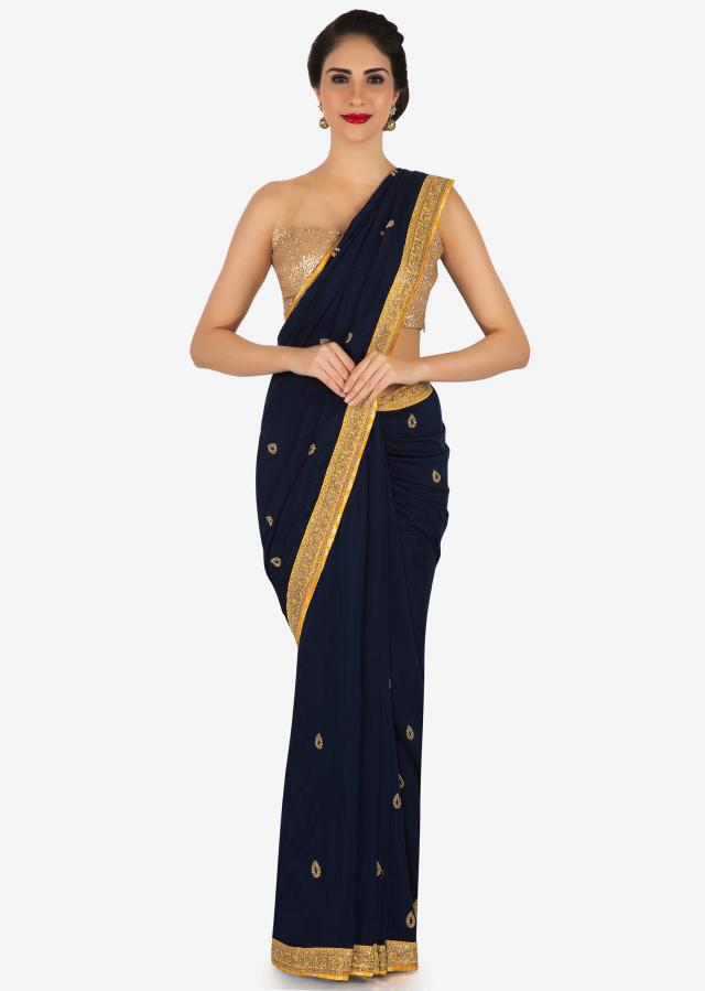 Navy blue saree in moti and zardosi butti along with contrast border only on Kalki