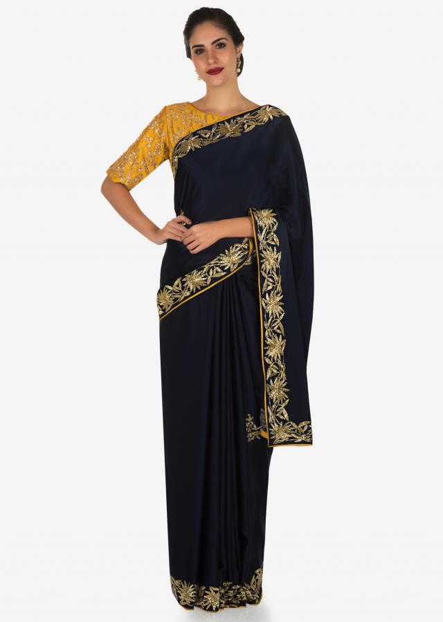 Navy blue saree with mustard blouse carved in heavy cut dana embroidery work only on Kalki