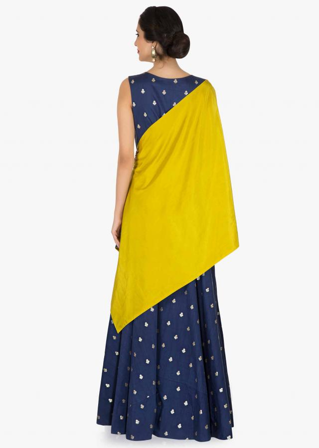 Navy blue suit matched with olive green fancy cape in embroidered butti only on Kalki