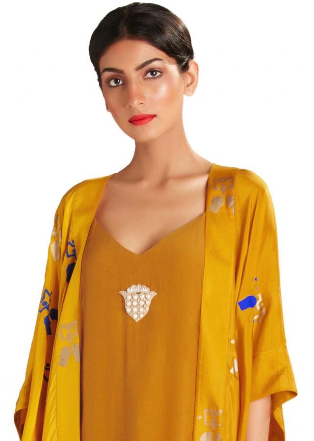 Ochre embroidered slip dress with kaften jacket by Masaba