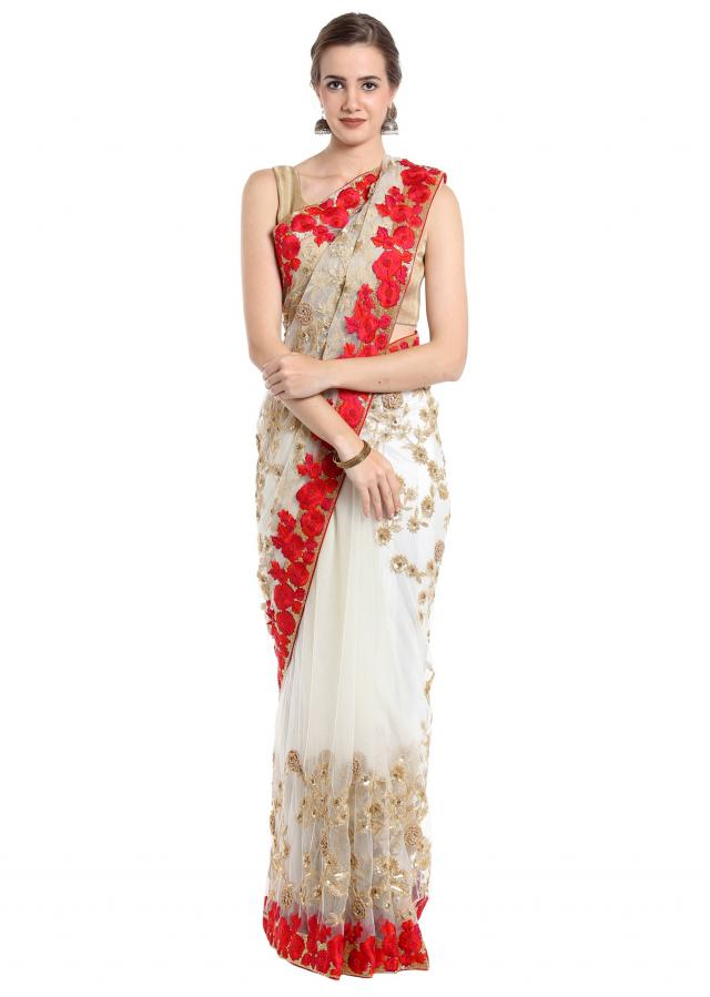 Off white saree embellished in gold zari and red thread work only on Kalki