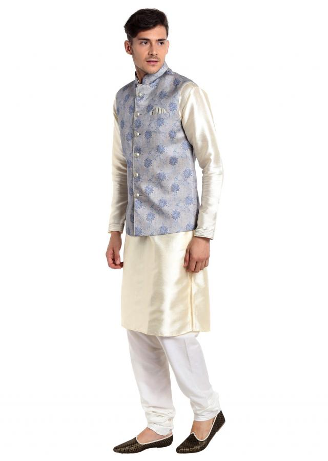 Off White kurta Coupled with Ice Blue Waistcoat Featuring Printed Ethnic Patterns only on Kalki