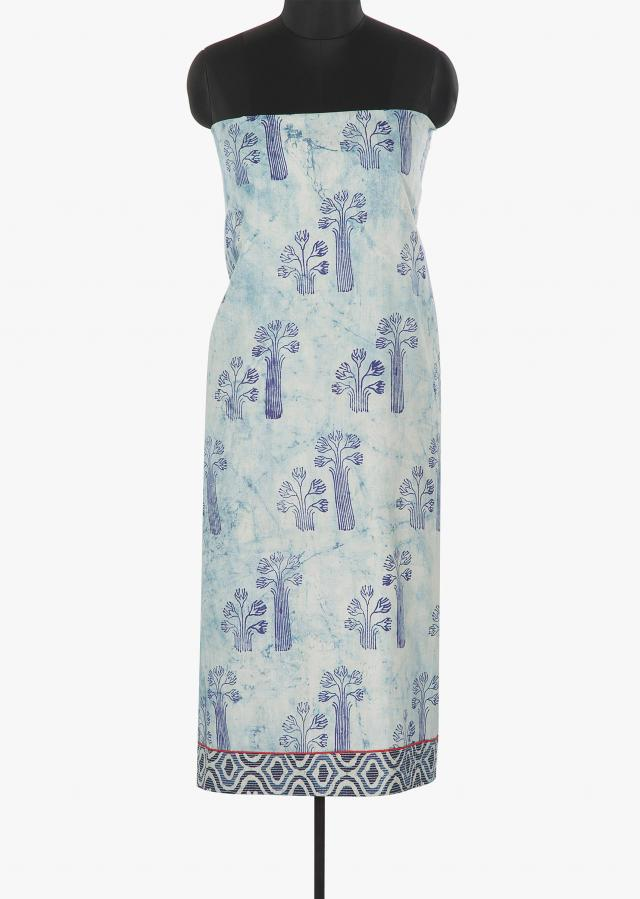 Off white unstitched suit in blue print further enhanced with thread work only on Kalki