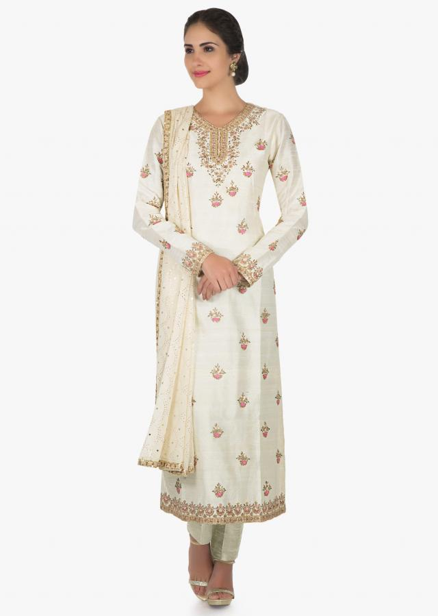 Off white suit in tussar silk adorn with zardosi and frenchknot embroidery butti work only on Kalki