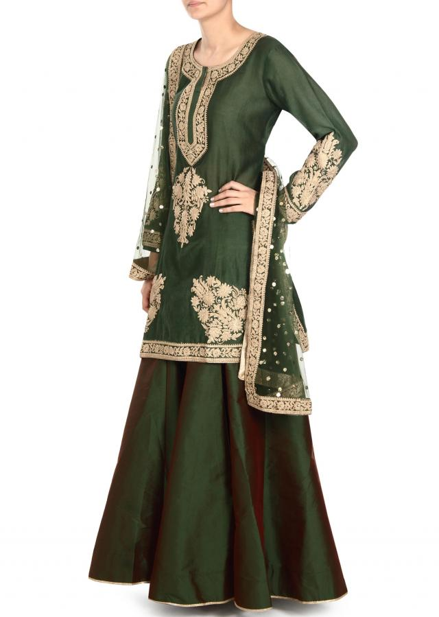 Olive green straight suit adorn in zari embroidery only on Kalki