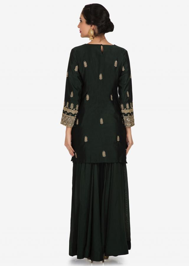 Olive green palazzo suit in raw silk adorn in zardosi and cutdana embroidery work only on Kalki