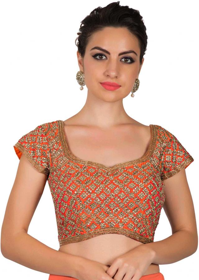 Orange blouse adorn in kundan and zardosi only on Kalki