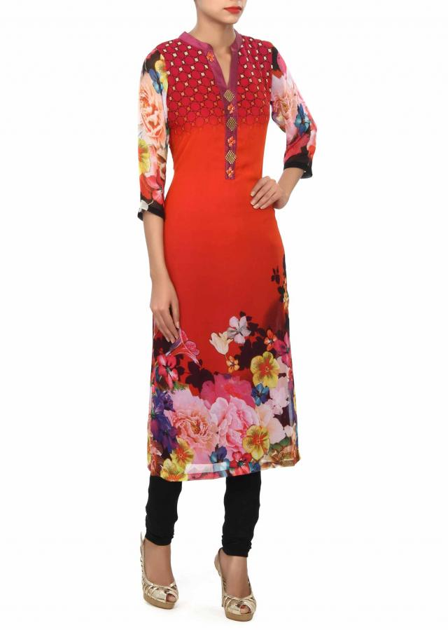 Orange kurti enhanced in print and fancy placket only on Kalki