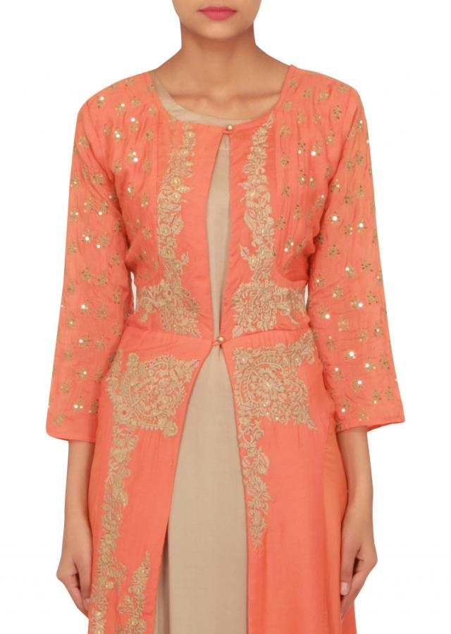 Orange long jacket in thread work with beige inner only on Kalki
