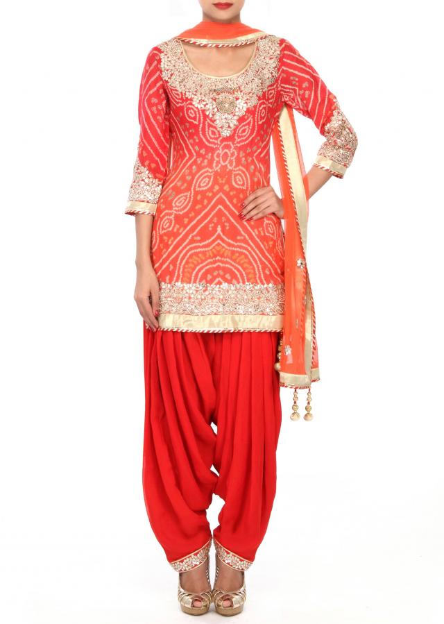 Orange Patiala suit embellished in gotta applique embroidery only on Kalki