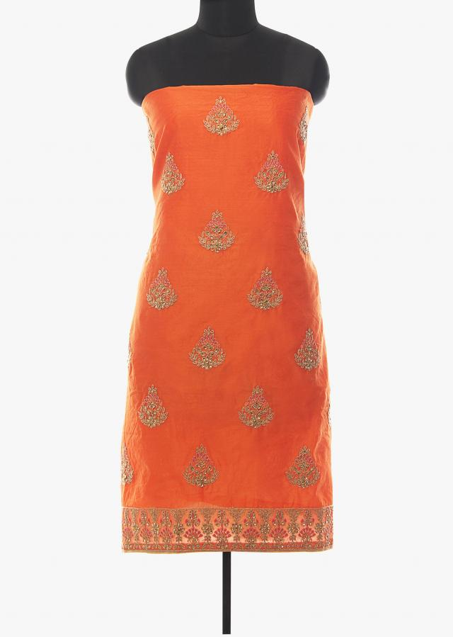 Orange unstitched suit in silk with cod zari and kundan butti only on Kalki