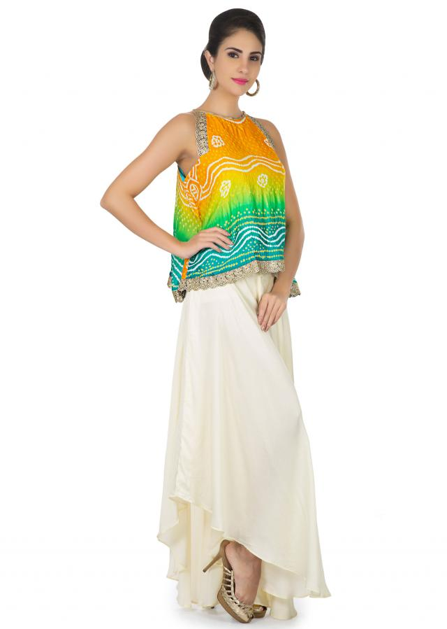 Orange yellow and blue bandhani top with white fancy palazzo pant only on Kalki