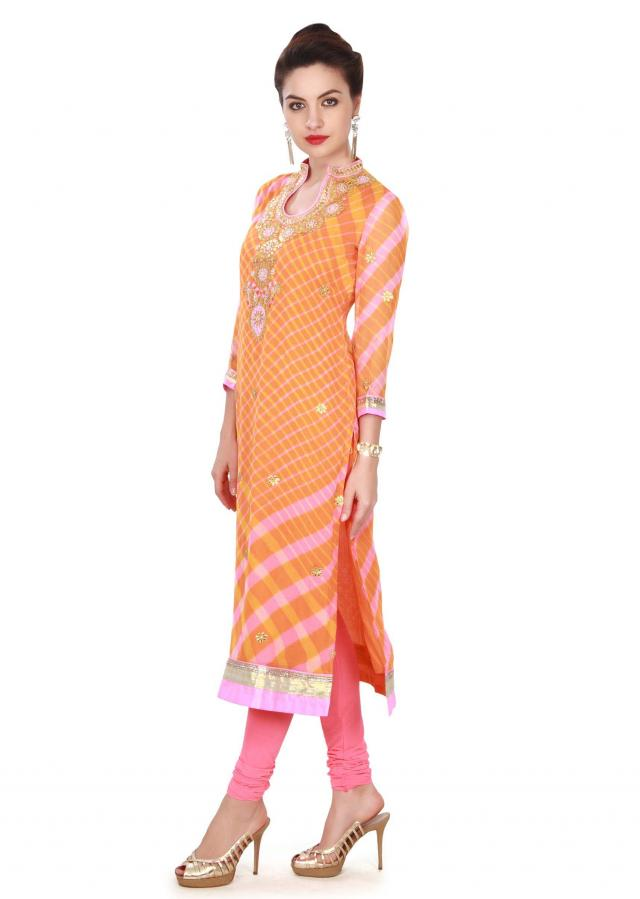 Orange and pink kurti with gotta patch work embroidery only on Kalki