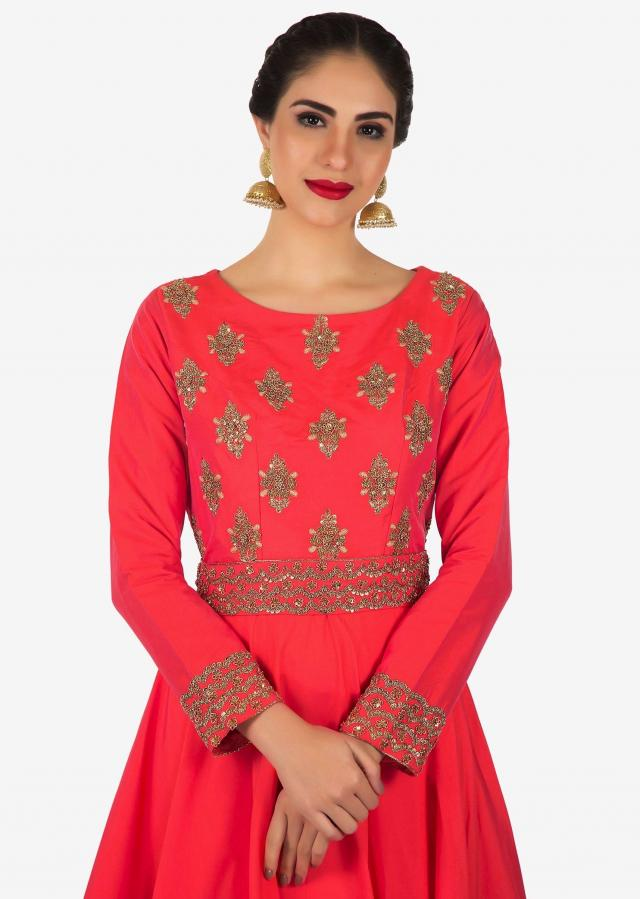 Orange gown in cotton silk with embroidered butti at bodice only on Kalki