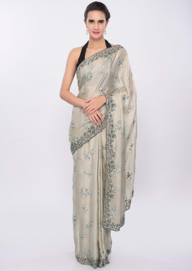 Pale sage green satin saree in floral resham embroidery and butti only on Kalki