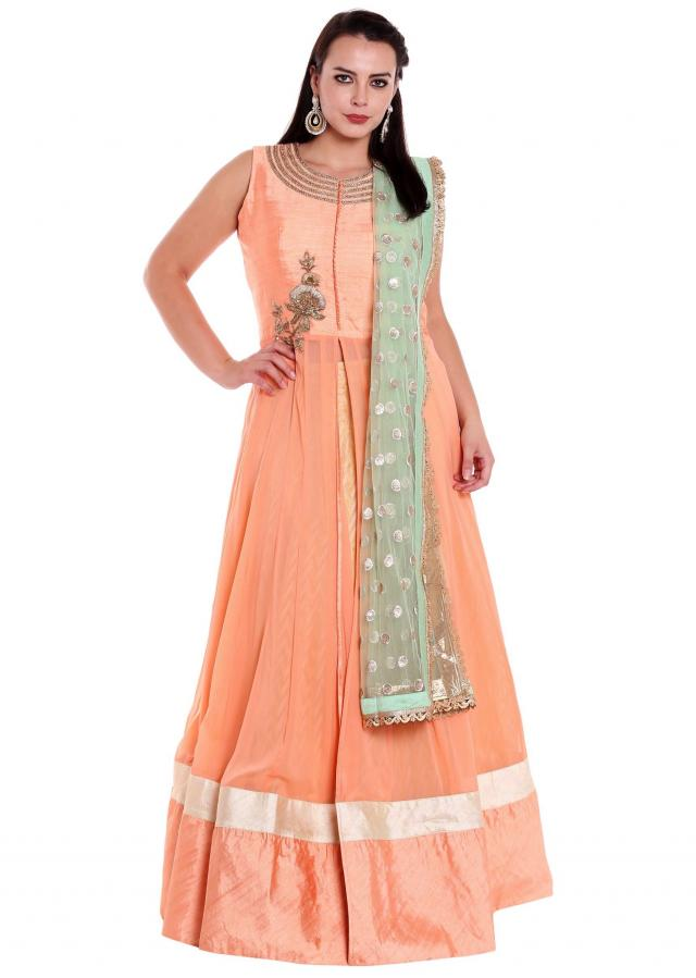 Peach anarkali suit matched with cream lehenga and straight pant only on Kalki