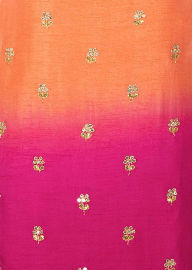 Peach and pink shaded unstitched suit with floral embroidered butti only on Kalki