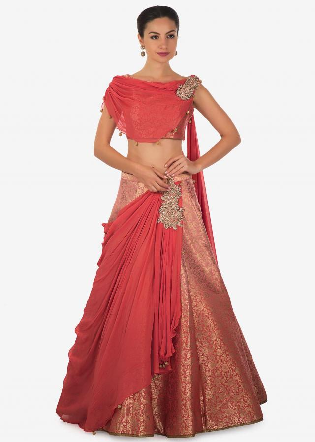 Peach brocade lehenga with pre stitched drape highlighted in zari and sequin butti only on Kalki