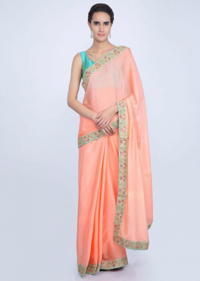 Peach chiffon saree with a contrasting embroidered raw silk border only on Kalki