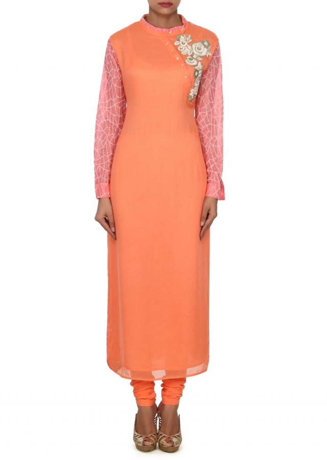 Peach kurti adorn in french knot embroidery only on Kalki