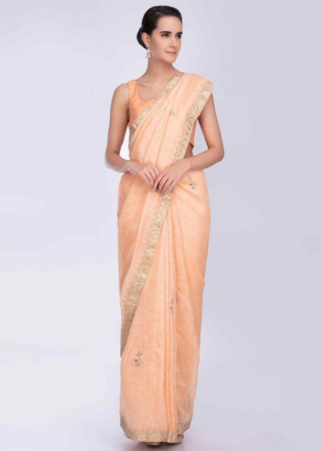 Peach linen saree with gotta, cord and zardosi embroidered butti and border only on Kalki