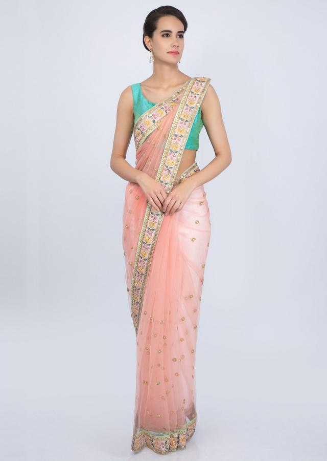 Peach net saree with floral embroidered butti and border only on Kalki