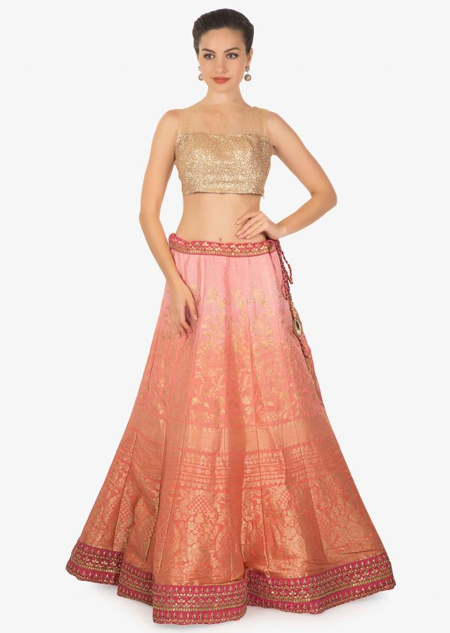 Peach orange shaded brocade silk lehenga paired with rani pink brocade dupatta only on kalki