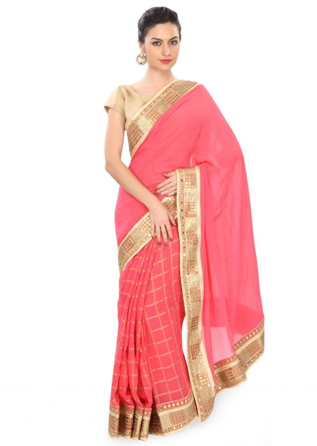 Peach saree adorn in foil and sequin border only on Kalki
