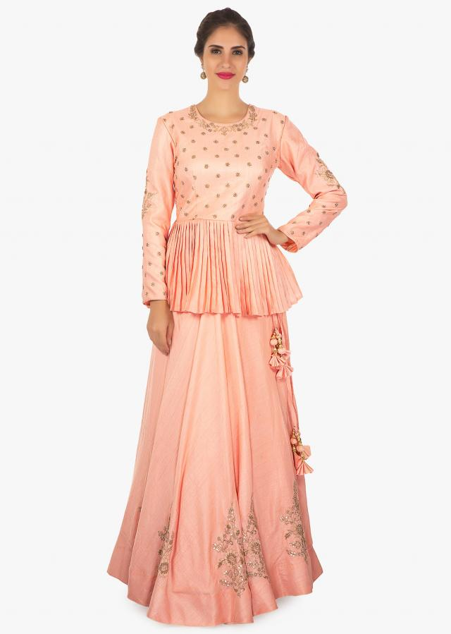 Peach silk lehenga with long blouse and a matching net dupatta only on Kalki