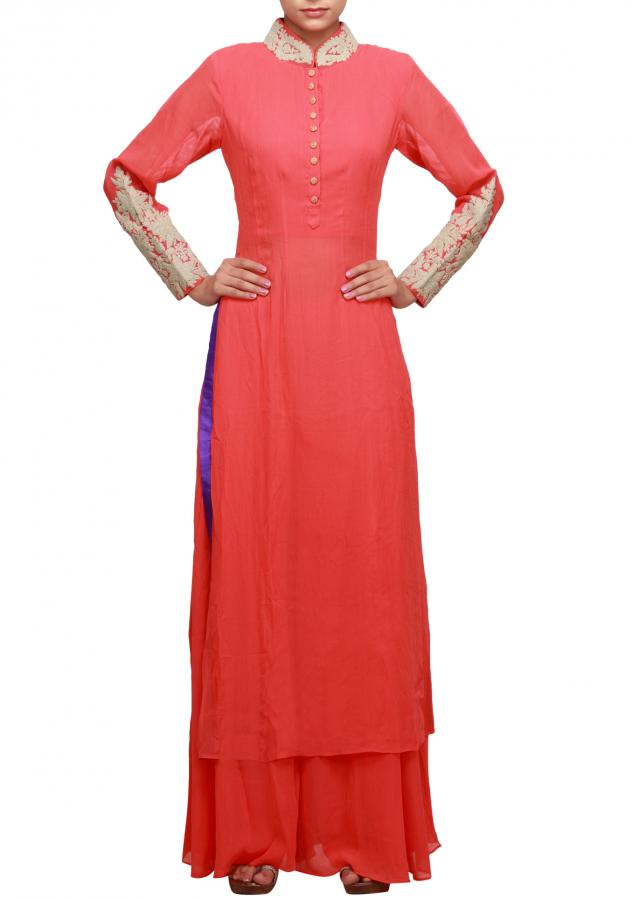 Peach straight fit suit featuring with embroidered collar and sleeve only on Kalki