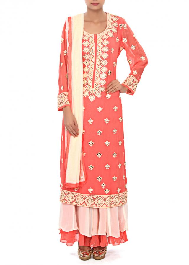 Peach straight suit embellished in mirror and thread work only on Kalki