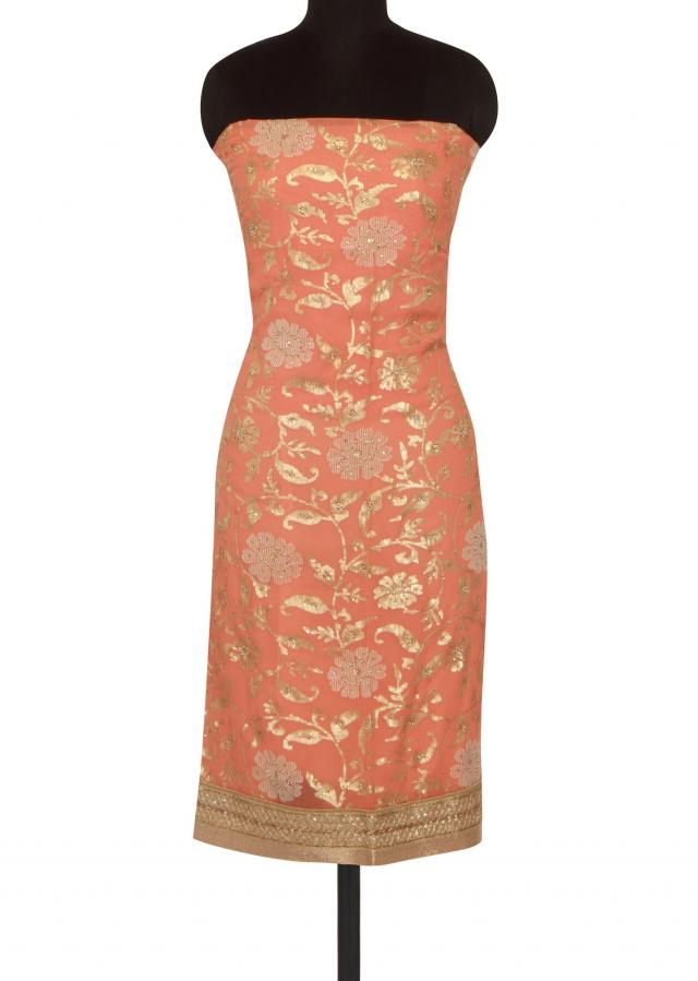 Peach unstitched suit adorn in sequin only on Kalki