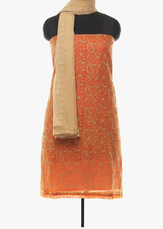 Peach unstitched suit in cotton silk with paisley motif embroidery only on Kalki