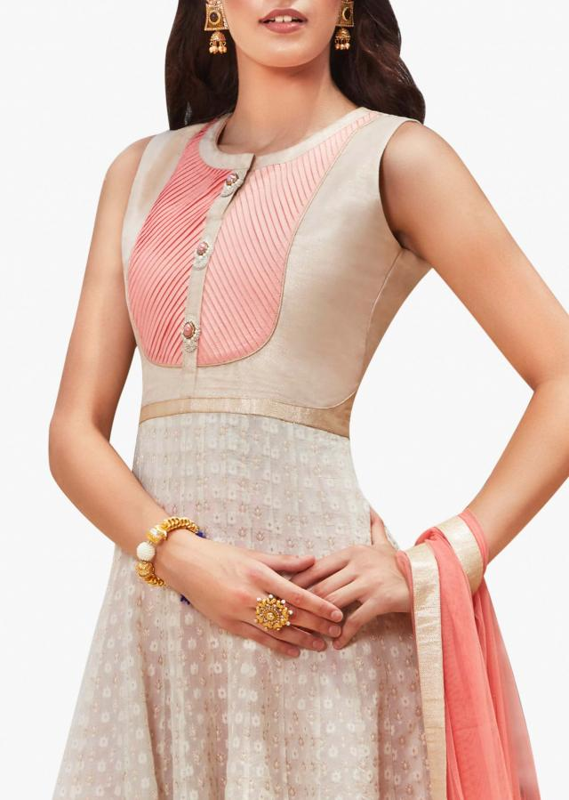 Peach and off-white anarkali suit embellished in fancy moti work at the placket