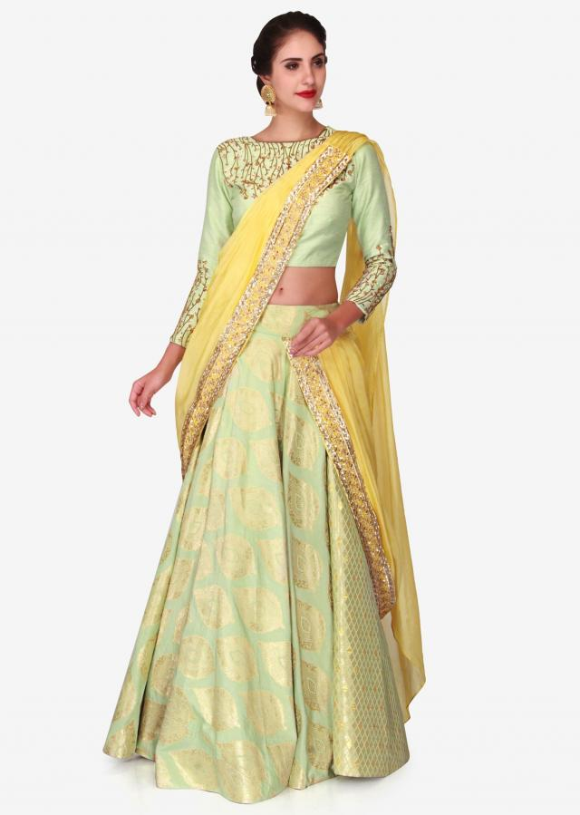 Light green brocade lehenga with a ready styled dupatta in yellow only on Kalki