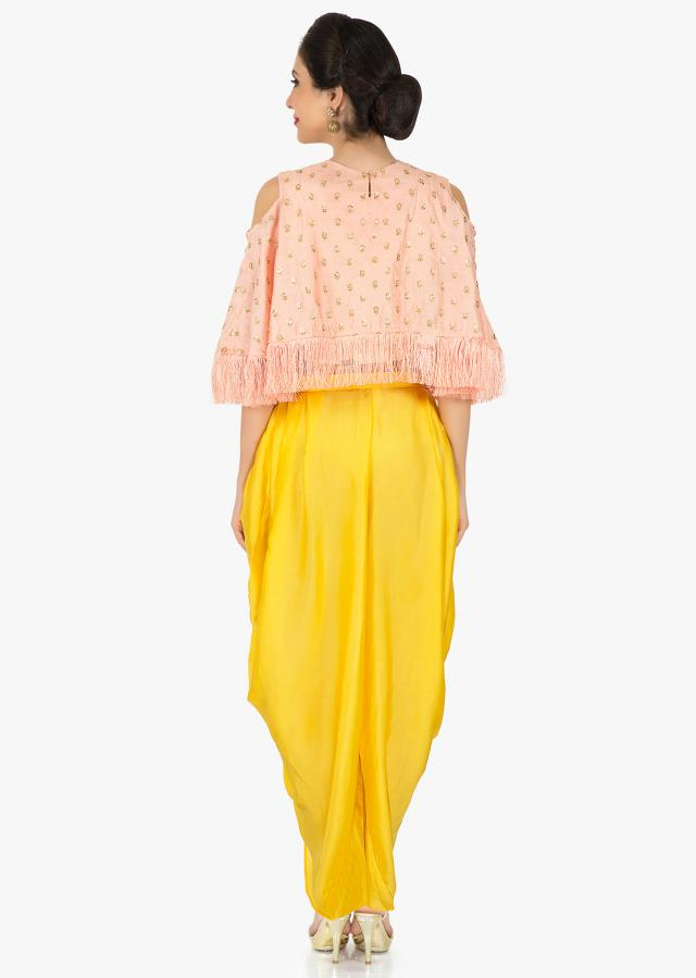 Peach cape and yellow dhoti suit featuring the moti sequin work only on Kalki