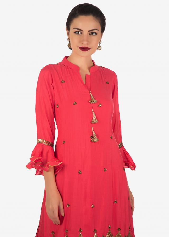 Peach double layer dress in cotton embellished in fancy tassel and sequin embroidery only on Kalki