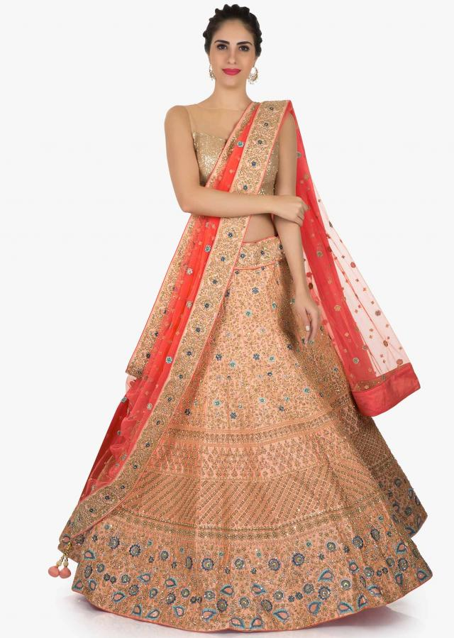 Peach lehenga in raw silk adorn with resham zari embroidery only on Kalki