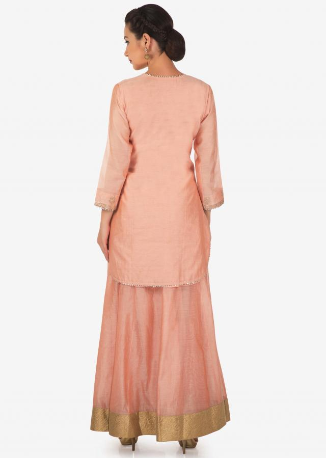 Peach straight suit matched with skirt in resham embroidered placket and butti only on Kalki