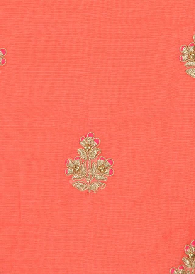 Peach unstitched suit in zari butti and pink leheriya dupatta only on Kalki