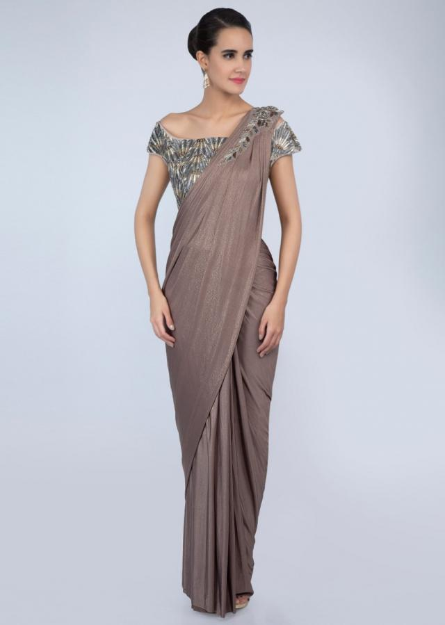 Peanut brown shimmer lycra saree with ready pleats and draped pallo only on Kalki